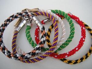 Bracelets: Pebblestone, JMU-Duke, Sand beach, Green clover, Pink-white polka dots, VCU-Ram